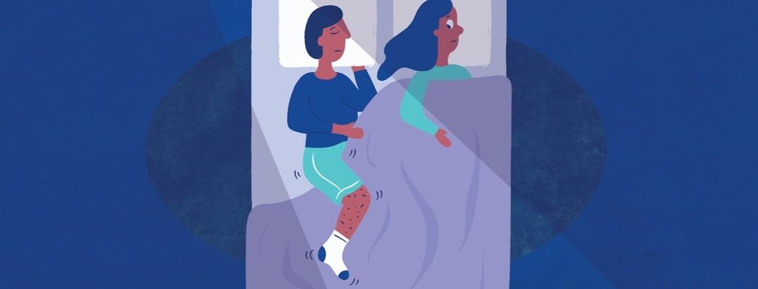 a couple in a bed, with woman is awake and the man with restless leg syndrome is asleep while his leg is moving