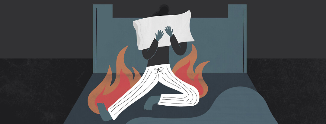 a woman sitting in her bed with a pillow over her face and flames around her legs